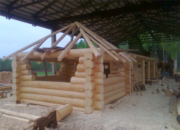 hand made log cabin - log house being constructed